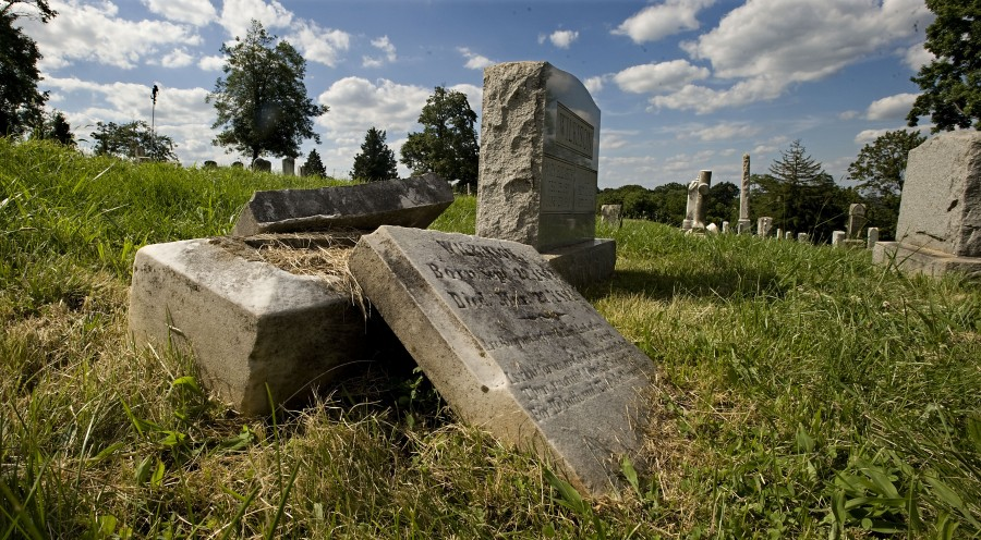 A toppled headstone in Prospect Hill Cemetery is one concern area residents have expressed about the 40-acre property in southern Front Royal they fear has been under -maintained.   Rich Cooley/Daily